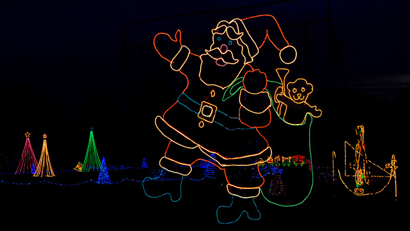 A holiday light display featuring Santa during Christmas in the Park at Longview Lake in Jackson County, MO