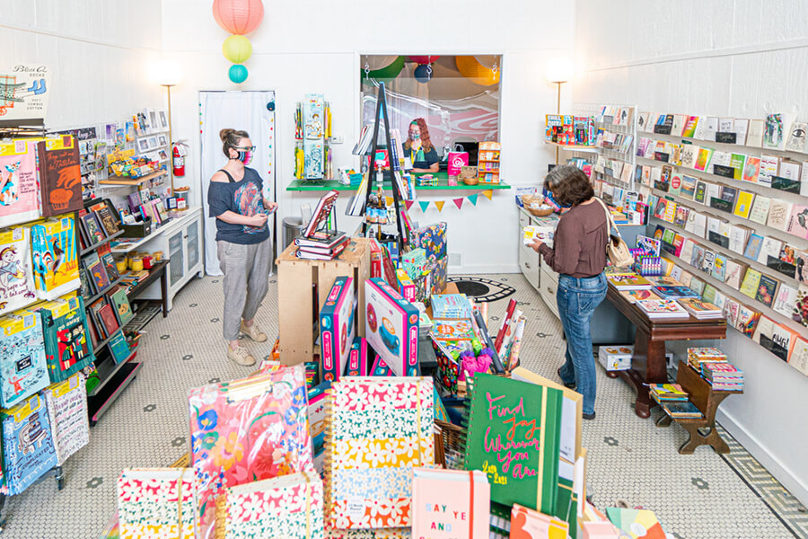 Customers shop inside Manic Snail boutique in St. Joseph, MO