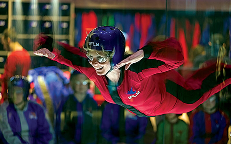 A woman indoor skydiving at iFly in Overland Park, KS